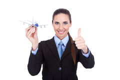 Attractive stewardess holding plane Stock Image