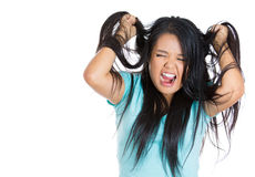 Attractive stressed woman pulling hair out Stock Photography