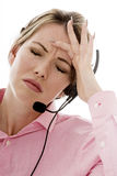 Attractive Stressed Young Business Woman Using a Telephone Heads Royalty Free Stock Photography