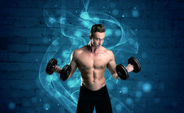 Attractive strong fitness guy lifting weight Stock Photography