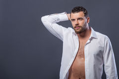 Attractive strong guy is expressing his desire Royalty Free Stock Photos
