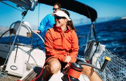 Attractive strong woman sailing with her boat. Attractive strong women sailing with her sail boat royalty free stock photo
