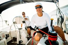 Attractive strong woman sailing with her boat. Attractive strong sport women sailing with her boat Royalty Free Stock Image