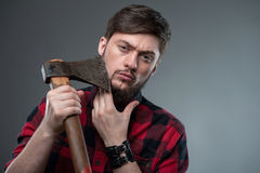 Attractive strong young man with strange axe Royalty Free Stock Photography
