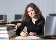 Attractive student. Attractive female student is preparing to the test Royalty Free Stock Image