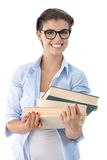 Attractive student with books smiling Royalty Free Stock Photo