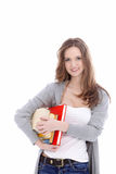 Attractive student carrying her books Stock Photo