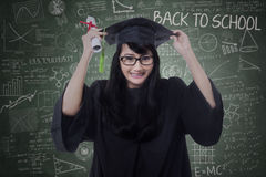 Attractive student celebrate graduation in class Stock Photos