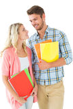 Attractive student couple smiling at each other Stock Images