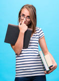 Attractive student girl in glasses with books Stock Photography