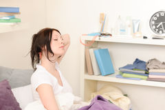 Attractive student girl wake up at home. Attractive high-school girl wake up in student apartment Royalty Free Stock Images