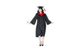 Attractive student in graduation cap with diploma jumping isolated. On white Royalty Free Stock Photo