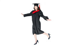 Attractive student in graduation cap with diploma jumping isolated. On white Stock Photo