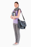 Attractive student holding books and her bag Stock Image