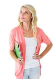 Attractive student holding notepads and thinking Royalty Free Stock Image