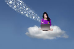 Attractive student with laptop on the cloud Stock Images
