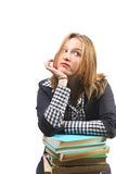 Attractive student leaning on stack of books royalty free stock images