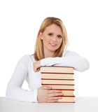 Attractive student with pile of books Stock Images