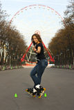 Attractive student rollerblading in summer Royalty Free Stock Photo