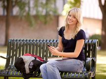 Attractive Student Sending Text Message Royalty Free Stock Photography