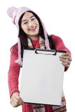Attractive student showing empty clipboard Royalty Free Stock Photo