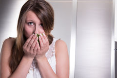 Attractive student is smelling basil Stock Images