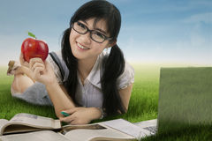 Attractive student studying at field 1 Royalty Free Stock Image