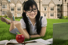 Attractive student studying outdoors 1 Royalty Free Stock Photo