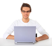 Attractive student using laptop. Computer. All on white background Royalty Free Stock Images
