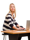 Attractive student using a laptop Royalty Free Stock Photo