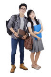 Attractive students couple standing in studio Stock Photo