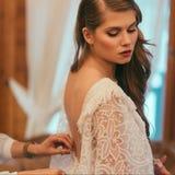 Attractive stylish bride wearing white bohemian wedding. Dress royalty free stock photography