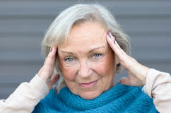 Attractive stylish elderly blue-eyed woman Stock Photography