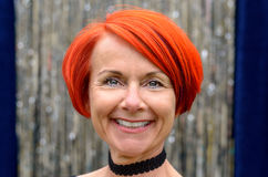 Attractive stylish vivacious redhead woman Royalty Free Stock Photos