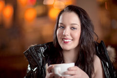 Attractive woman drinking coffee Stock Images