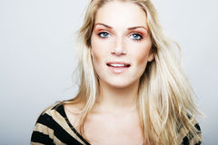 Attractive stylish woman with long blond hair Stock Images