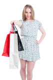 Attractive stylish woman offer gift or shopping bags Stock Photos