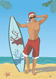 Attractive Surfer in Santa's Cap Royalty Free Stock Photo
