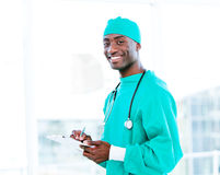Attractive surgeon making notes Stock Images