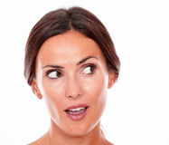 Attractive surprised brunette young woman only Royalty Free Stock Image