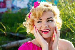 Attractive surprised pin up girl Stock Images