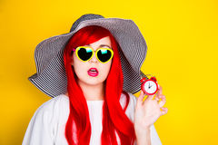 Attractive surprised red-haired young woman in sunglasses and ha Royalty Free Stock Photography