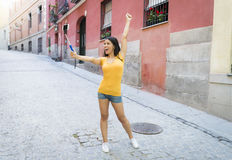Attractive and sweet latin woman smiling happy taking self portrait selfie photo with mobile phone. Young attractive and sweet latin woman smiling happy taking Stock Photo