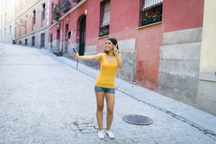 Attractive and sweet latin woman smiling happy taking self portrait selfie photo with mobile phone. Young attractive and sweet latin woman smiling happy taking Stock Images