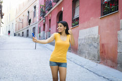 Attractive and sweet latin woman smiling happy taking self portrait selfie photo with mobile phone. Young attractive and sweet latin woman smiling happy taking Royalty Free Stock Images