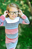 Attractive sweet little girl wearing glasses  Royalty Free Stock Photos