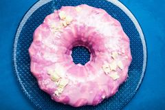 Attractive sweet pink cake in the form of a donut, close-up stock image