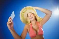 Attractive taking selfie against sky Stock Images