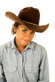 Attractive tan girl wearing denim shirt and a cowboy hat Royalty Free Stock Photography