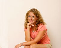 Attractive, Tanned Lady. A smiling, tanned lady looks into the camera Royalty Free Stock Image